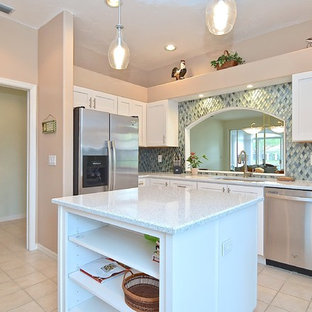 Inspiration for a medium sized classic kitchen/diner in Tampa with a submerged sink, recessed-panel cabinets, white cabinets, recycled glass countertops, blue splashback, glass tiled splashback, stainless steel appliances, an island and yellow worktops.