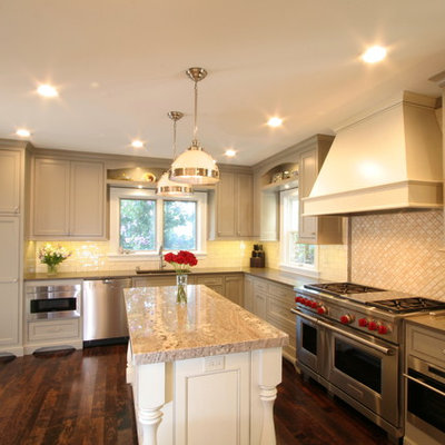 Eat-in kitchen - large traditional l-shaped dark wood floor eat-in kitchen idea in Milwaukee with an undermount sink, beaded inset cabinets, gray cabinets, granite countertops, white backsplash, subway tile backsplash, stainless steel appliances and an island