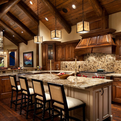 Example of a mountain style open concept kitchen design in Other with raised-panel cabinets, dark wood cabinets, brown backsplash and mosaic tile backsplash