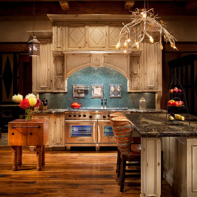 Kitchen - rustic kitchen idea in Other with beige cabinets, blue backsplash and stainless steel appliances