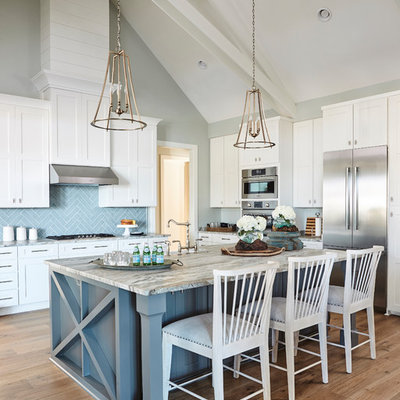 Inspiration for a cottage u-shaped medium tone wood floor and brown floor kitchen remodel in Atlanta with shaker cabinets, blue backsplash, stainless steel appliances, an island and white cabinets