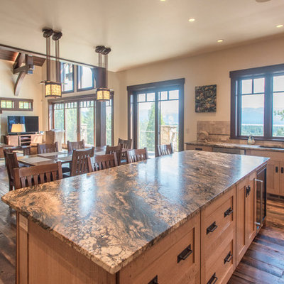 Example of a large mountain style l-shaped dark wood floor and blue floor open concept kitchen design in Boise with an undermount sink, recessed-panel cabinets, light wood cabinets, granite countertops, beige backsplash, terra-cotta backsplash, paneled appliances, an island and gray countertops