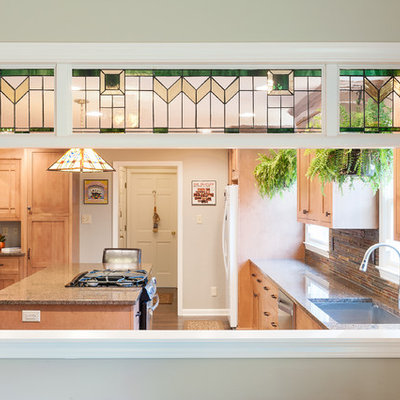 Mid-sized arts and crafts l-shaped medium tone wood floor eat-in kitchen photo in Indianapolis with an undermount sink, shaker cabinets, medium tone wood cabinets, granite countertops, multicolored backsplash, stone tile backsplash, stainless steel appliances and an island