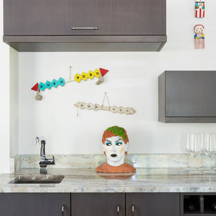 Mid-sized eclectic enclosed kitchen remodeling - Inspiration for a mid-sized eclectic u-shaped enclosed kitchen remodel in Chicago with flat-panel cabinets, gray cabinets, white backsplash, an undermount sink, granite countertops, stone slab backsplash and no island