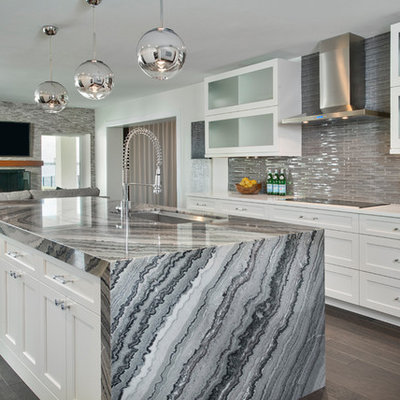 Inspiration for a mid-sized contemporary galley dark wood floor and brown floor open concept kitchen remodel in Tampa with an undermount sink, shaker cabinets, white cabinets, glass tile backsplash, stainless steel appliances, marble countertops, gray backsplash and an island