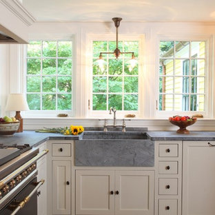 Example Of A Classic L Shaped Eat In Kitchen Design In Boston With A