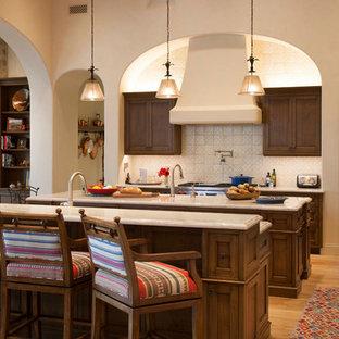 Southwestern kitchen designs - Example of a southwest kitchen design in Phoenix