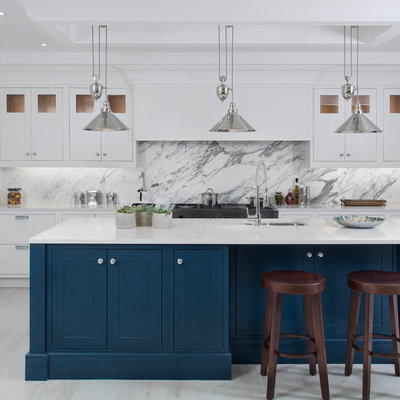 Example of a mid-sized transitional l-shaped light wood floor and white floor kitchen design in Other with an undermount sink, shaker cabinets, quartzite countertops, gray backsplash, marble backsplash, stainless steel appliances, an island and blue cabinets