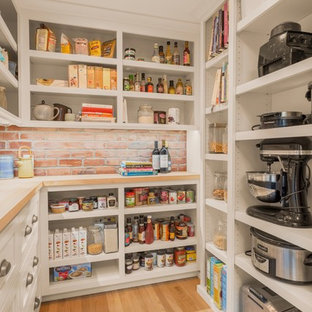 Classic u-shaped kitchen pantry in Seattle with open cabinets, white cabinets, brick splashback, light hardwood flooring, no island and beige floors.