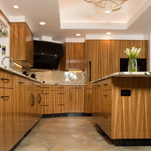 Design ideas for a contemporary kitchen in Boston with a submerged sink, light wood cabinets, granite worktops, yellow splashback, ceramic splashback, black appliances, ceramic flooring, an island, multi-coloured floors and multicoloured worktops.