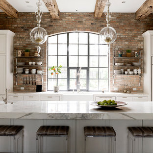Design ideas for a transitional galley kitchen in Houston with a farmhouse sink, recessed-panel cabinets, white cabinets and panelled appliances.
