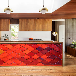 Inspiration for a midcentury kitchen in Portland with flat-panel cabinets, panelled appliances, with island, medium wood cabinets, white splashback and medium hardwood floors.