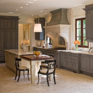 Large traditional enclosed kitchen ideas - Inspiration for a large timeless u-shaped travertine floor enclosed kitchen remodel in Atlanta with an island, gray cabinets, marble countertops, a farmhouse sink, stainless steel appliances, raised-panel cabinets, white backsplash and stone slab backsplash
