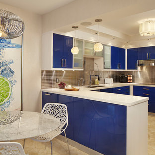 Mid-sized contemporary u-shaped eat-in kitchen in Miami with flat-panel cabinets, blue cabinets, metallic splashback, metal splashback, a drop-in sink, quartzite benchtops, stainless steel appliances, marble floors and a peninsula.