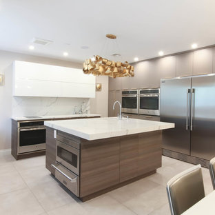 Design ideas for a large contemporary u-shaped eat-in kitchen in New York with an undermount sink, flat-panel cabinets, brown cabinets, quartzite benchtops, white splashback, stone slab splashback, stainless steel appliances, ceramic floors, with island, grey floor and yellow benchtop.