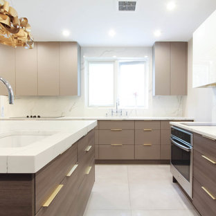 Photo of a large contemporary u-shaped eat-in kitchen in New York with an undermount sink, flat-panel cabinets, brown cabinets, quartzite benchtops, white splashback, stone slab splashback, stainless steel appliances, ceramic floors, with island, grey floor and yellow benchtop.