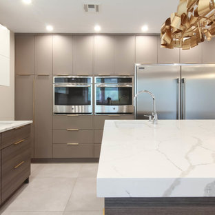 This is an example of a large contemporary u-shaped eat-in kitchen in New York with an undermount sink, flat-panel cabinets, brown cabinets, quartzite benchtops, white splashback, stone slab splashback, stainless steel appliances, ceramic floors, with island, grey floor and yellow benchtop.