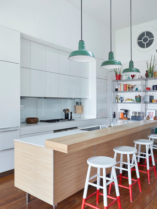 eclectic galley dark wood floor and brown floor kitchen idea in new york with an island - Houzz Interior Design Ideas