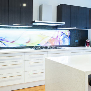 Mid-sized modern eat-in kitchen ideas - Inspiration for a mid-sized modern galley light wood floor eat-in kitchen remodel in Melbourne with an undermount sink, open cabinets, white cabinets, quartz countertops, black backsplash, glass tile backsplash and stainless steel appliances