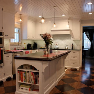 Mid-sized modern enclosed kitchen appliance - Inspiration for a mid-sized modern l-shaped linoleum floor enclosed kitchen remodel in Philadelphia with a farmhouse sink, white cabinets, white backsplash, stainless steel appliances, an island, shaker cabinets, wood countertops and subway tile backsplash