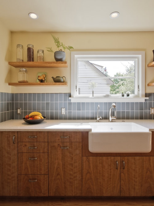 371 kitchen design photos with flat panel cabinets and recycled glass