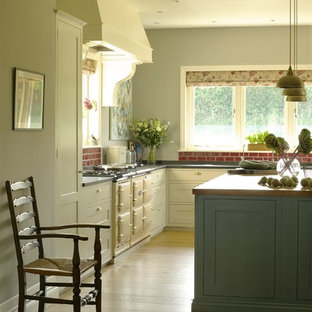 Huge farmhouse eat-in kitchen ideas - Eat-in kitchen - huge country medium tone wood floor eat-in kitchen idea in Wiltshire with a drop-in sink, shaker cabinets, blue cabinets, granite countertops, red backsplash, subway tile backsplash, colored appliances and an island