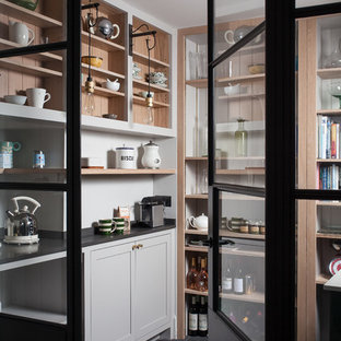 Inspiration for a scandinavian kitchen pantry in Kent with open cabinets, white cabinets, white splashback, timber splashback and no island.