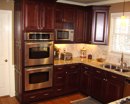 Winchester cherry cathedral door style by shenandoah cabinetry for Cathedral style kitchen cabinets