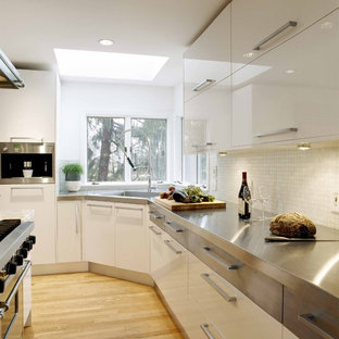 Example Of A Trendy Kitchen Design In Boston With Stainless Steel  Appliances, Concrete Countertops,