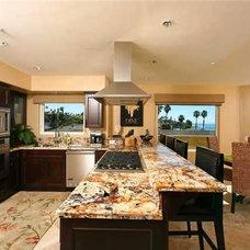 Mediterranean Kitchen by Nau Builders, Inc.