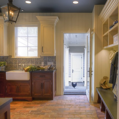 Mountain style brick floor kitchen photo in San Francisco with a farmhouse sink, blue backsplash, recessed-panel cabinets and beige cabinets