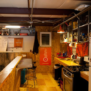 Small industrial eat-in kitchen designs - Small urban galley plywood floor eat-in kitchen photo in San Francisco with an undermount sink, open cabinets, light wood cabinets, wood countertops, orange backsplash, metal backsplash, stainless steel appliances and no island