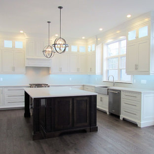Inspiration for a large traditional kitchen in Other with a farmhouse sink, flat-panel cabinets, white cabinets, stainless steel appliances, with island, pink floor and white benchtop.