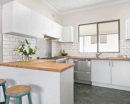 Mid sized contemporary u shaped separate kitchen in sydney with a double bowl