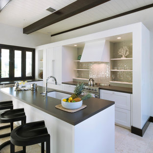 Transitional kitchen appliance - Example of a transitional kitchen design in Charleston with an undermount sink, open cabinets, white cabinets, beige backsplash, subway tile backsplash, stainless steel appliances and an island
