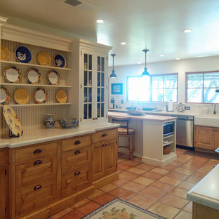 Inspiration for a large country l-shaped separate kitchen in San Luis Obispo with a farmhouse sink, beaded inset cabinets, white cabinets, limestone benchtops, white splashback, stone tile splashback, stainless steel appliances, terra-cotta floors and with island.