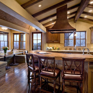 Rustic kitchen ideas - Kitchen - rustic kitchen idea in San Francisco with raised-panel cabinets, dark wood cabinets and beige backsplash