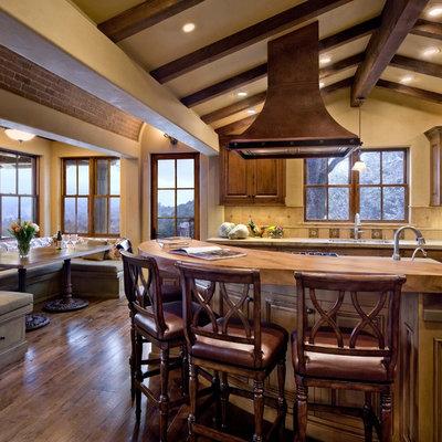 Kitchen - rustic kitchen idea in San Francisco with raised-panel cabinets, dark wood cabinets and beige backsplash