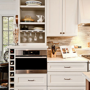 Example of a classic kitchen design in Atlanta with stainless steel appliances