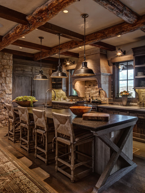 Rustic kitchen appliance - Rustic l-shaped brown floor and dark wood floor  kitchen idea