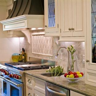Example of a classic kitchen design in Boston with beaded inset cabinets, white cabinets, white backsplash, stone tile backsplash and paneled appliances