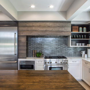 Photo of a large contemporary l-shaped separate kitchen in Chicago with a double-bowl sink, open cabinets, white cabinets, quartzite benchtops, grey splashback, porcelain splashback, stainless steel appliances, ceramic floors, no island and beige floor.