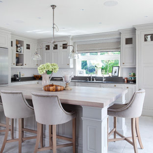 Design ideas for a traditional kitchen in West Midlands with beaded cabinets, grey cabinets, stainless steel appliances, an island and grey floors.