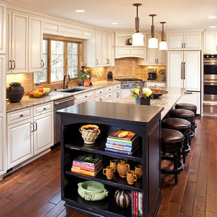 Example of a classic kitchen design in Minneapolis with an undermount sink, raised-panel cabinets, white cabinets, beige backsplash and subway tile backsplash