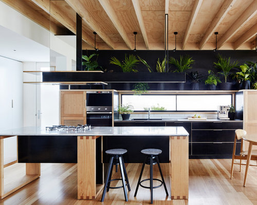 Small Contemporary Open Concept Kitchen Designs   Example Of A Small Trendy  Light Wood Floor Open Part 70