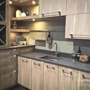Mid-sized modern kitchen appliance - Mid-sized minimalist l-shaped kitchen photo in Denver with an undermount sink, flat-panel cabinets, light wood cabinets, concrete countertops, gray backsplash and stainless steel appliances