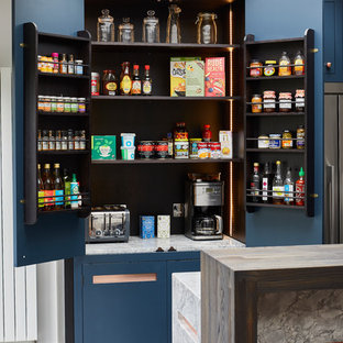 Photo of a large contemporary single-wall kitchen pantry in London with a built-in sink, flat-panel cabinets, blue cabinets, granite worktops, grey splashback, marble splashback, stainless steel appliances, ceramic flooring, an island, grey floors and grey worktops.
