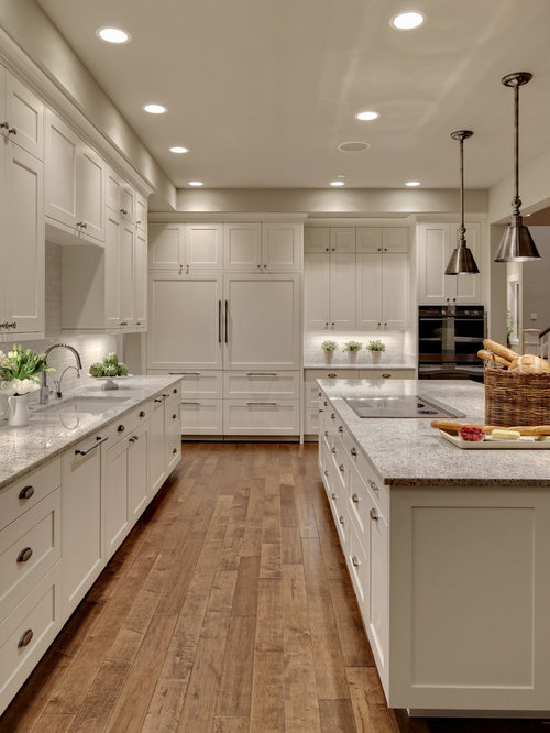 Huge Transitional Kitchen Photos   Example Of A Huge Transitional Medium  Tone Wood Floor Kitchen Design