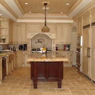 Design ideas for a mediterranean u-shaped kitchen in Los Angeles with panelled appliances, a farmhouse sink, raised-panel cabinets, beige cabinets, beige splashback, marble benchtops, ceramic floors and with island.