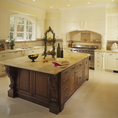 Large elegant u-shaped porcelain tile kitchen photo in Los Angeles with stainless steel appliances, an undermount sink, raised-panel cabinets, white cabinets, beige backsplash, marble countertops, porcelain backsplash and an island